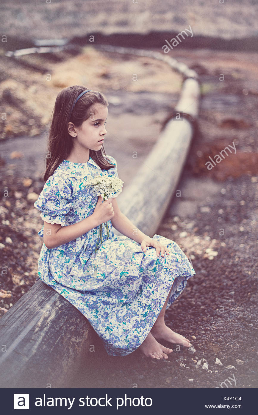 Girl holding a bunch of flowers - Stock Image
