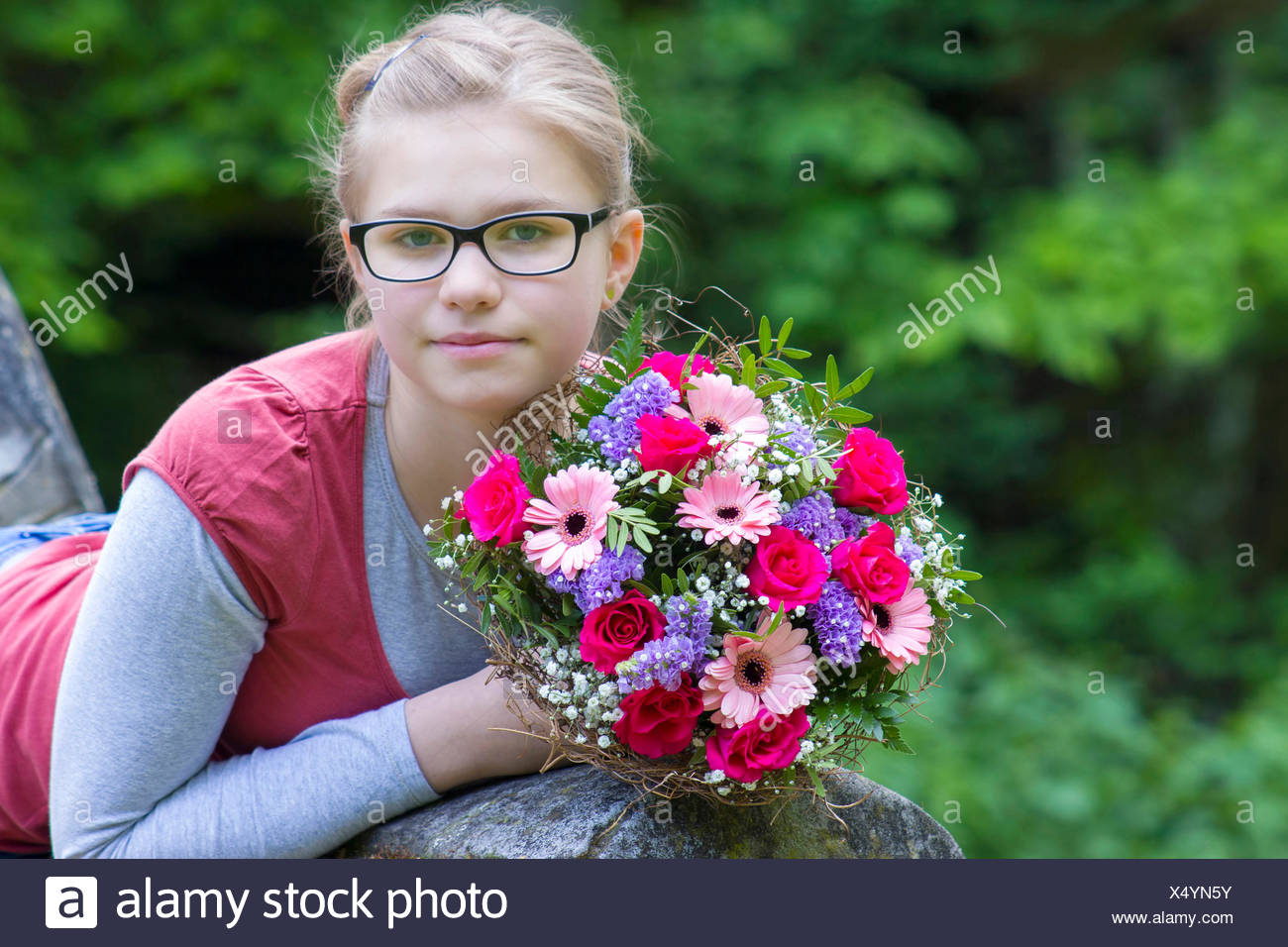 Portrait of a beautiful young girl with flowers stock photo portrait of a beautiful young girl with flowers izmirmasajfo