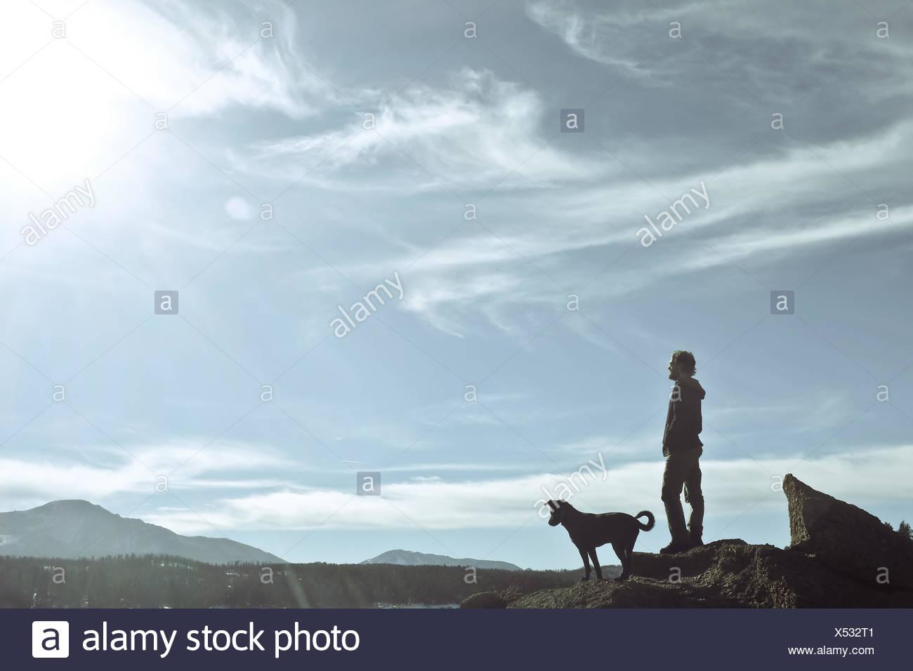 Man standing with his dog, Pikes Peak, Colorado, America, USA - Stock Image