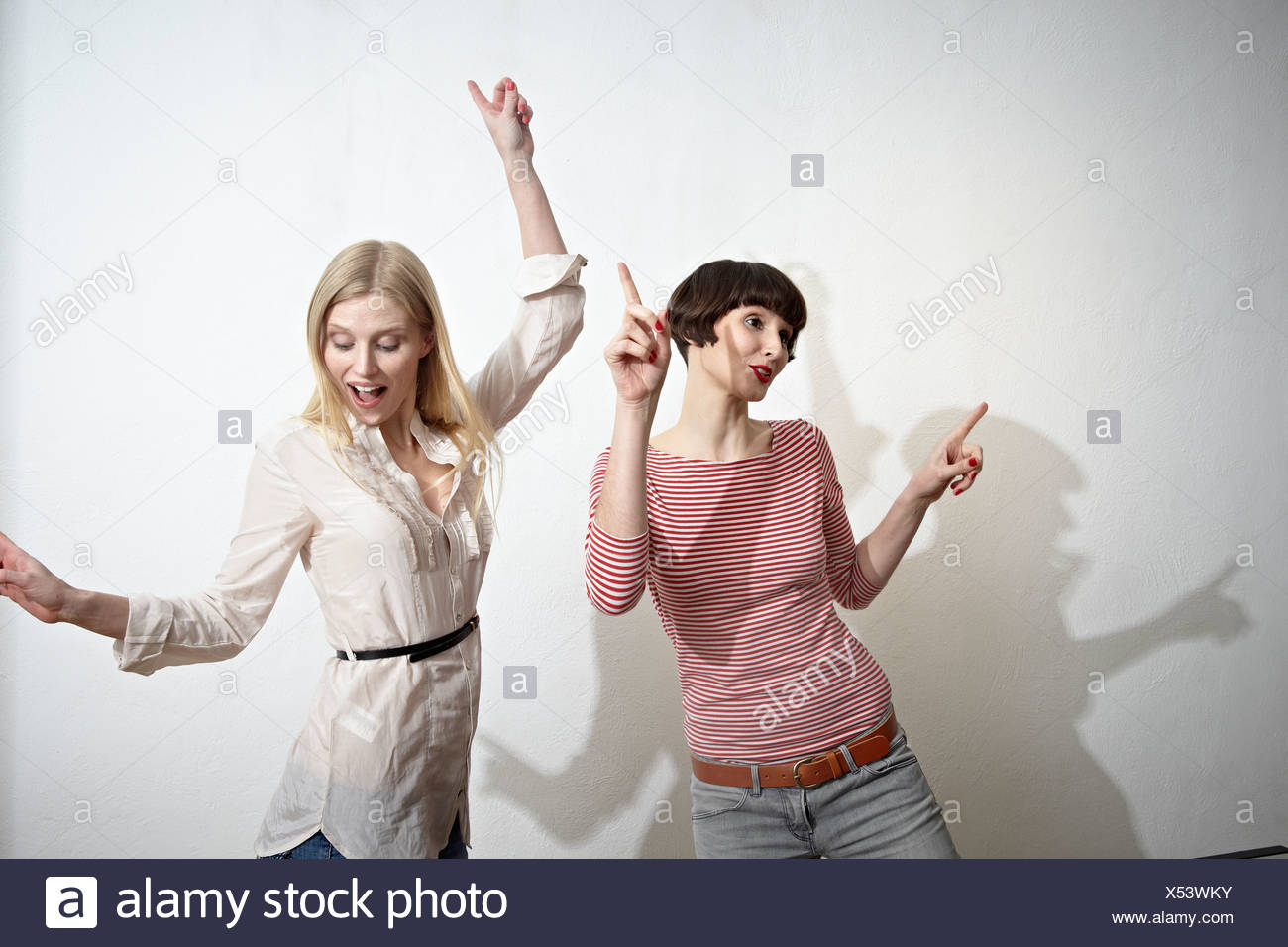 Germany, Cologne, Young women having fun, smiling - Stock Image
