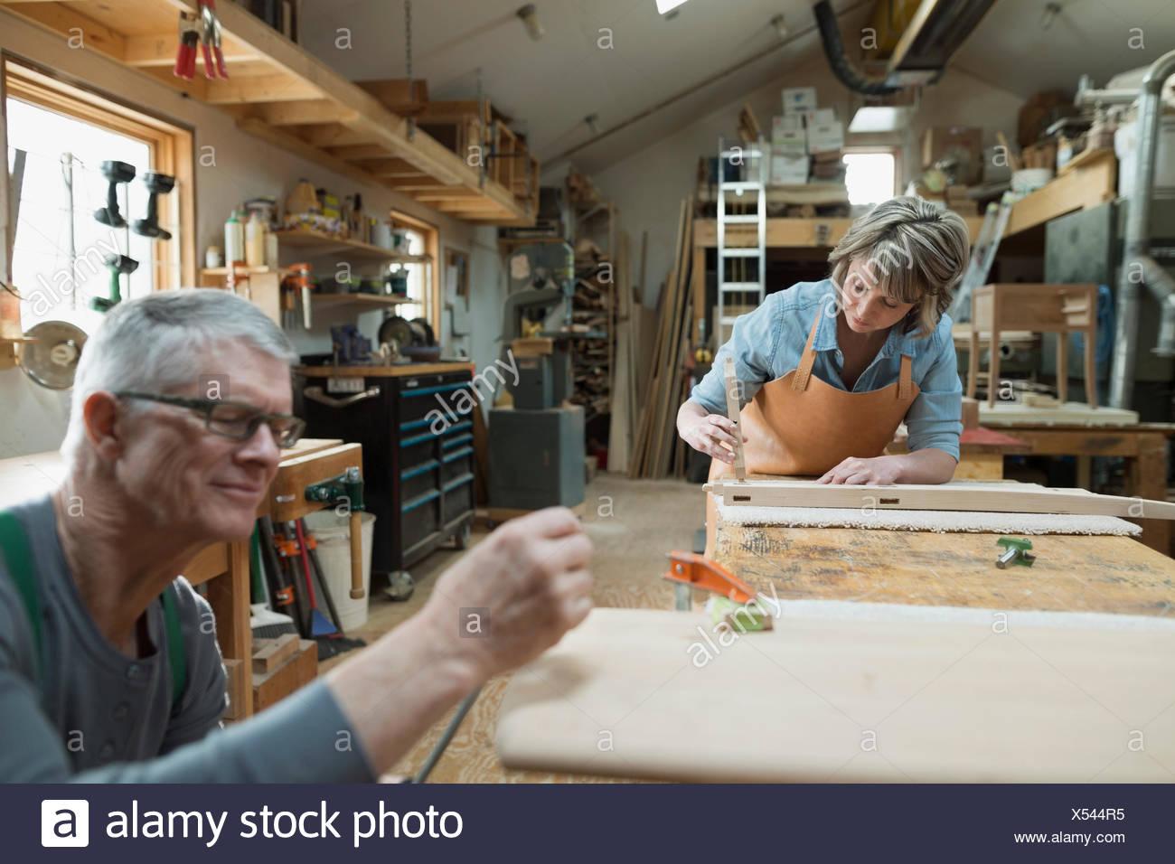 Carpenters working in workshop - Stock Image