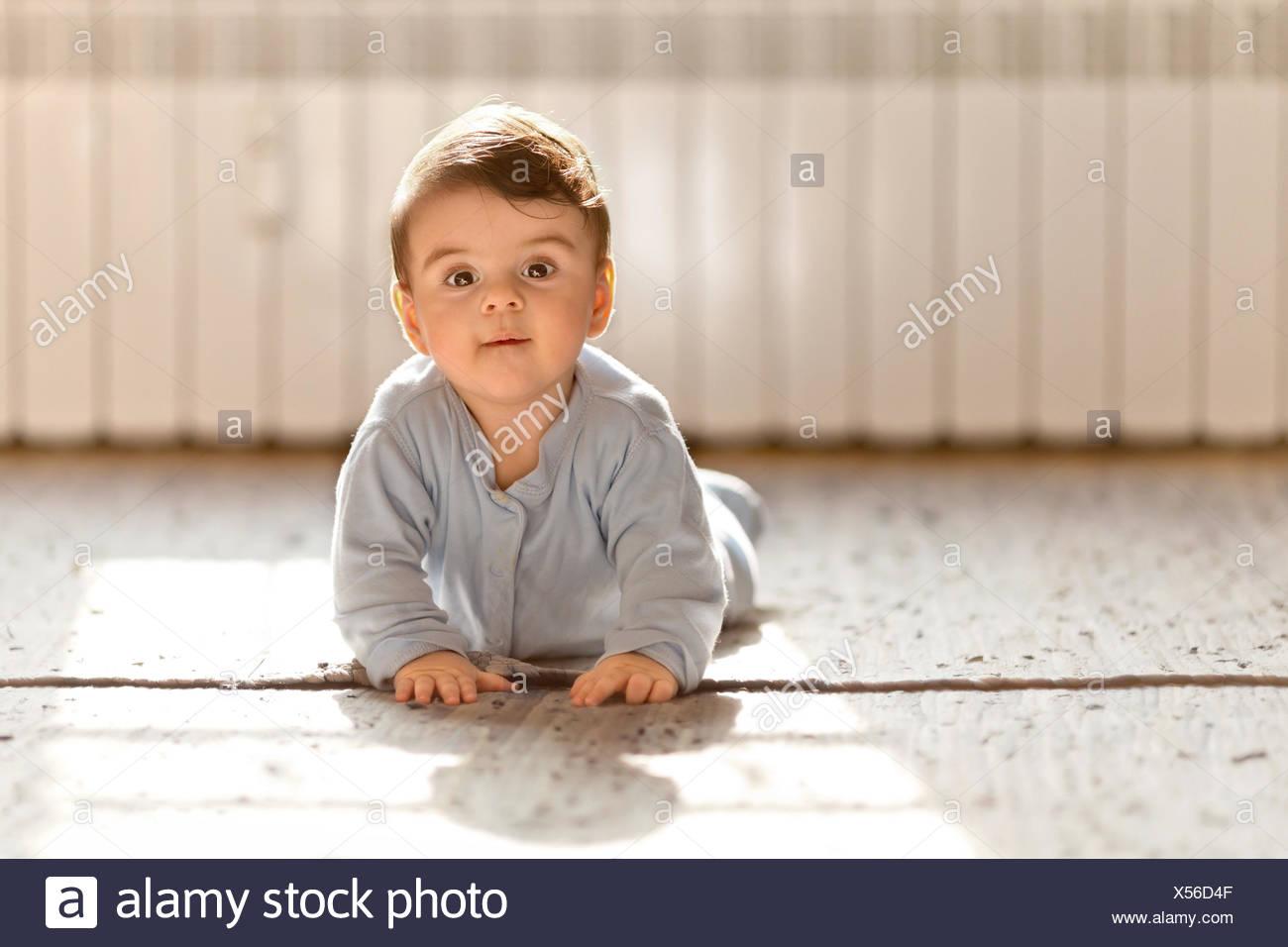 Baby boy looking at camera - Stock Image