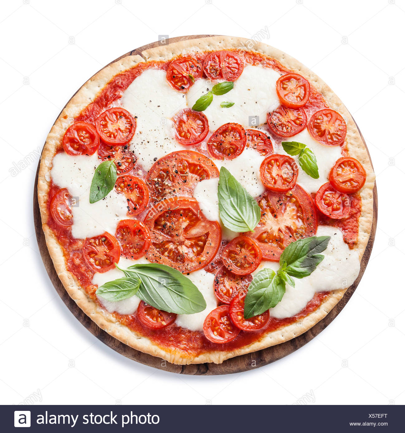 Italian pizza with tomatoes and mozzarella on white background - Stock Image