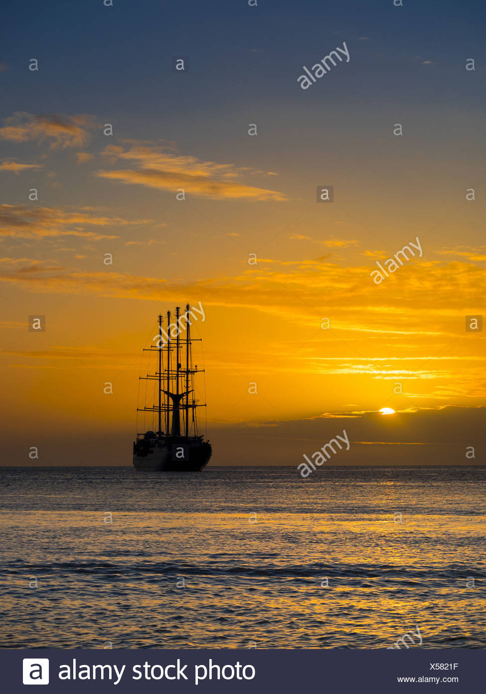 Caribbean, St. Lucia, Sailing cruise ship Wind Star at sunset - Stock Image