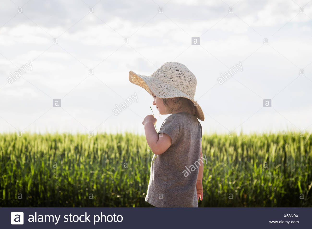 Portrait of girl in straw hat - Stock Image