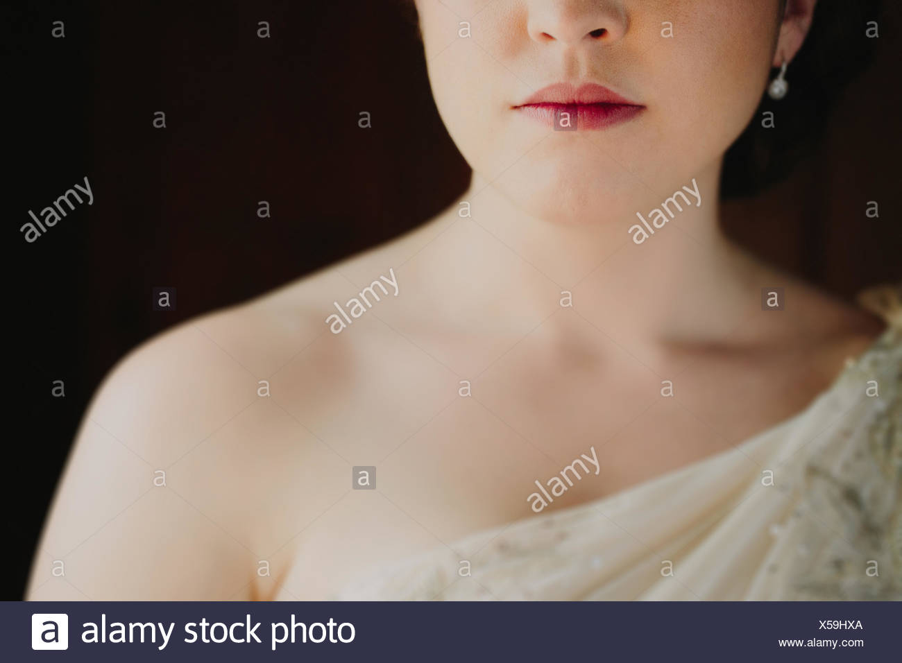 Close up of woman in wedding dress - Stock Image