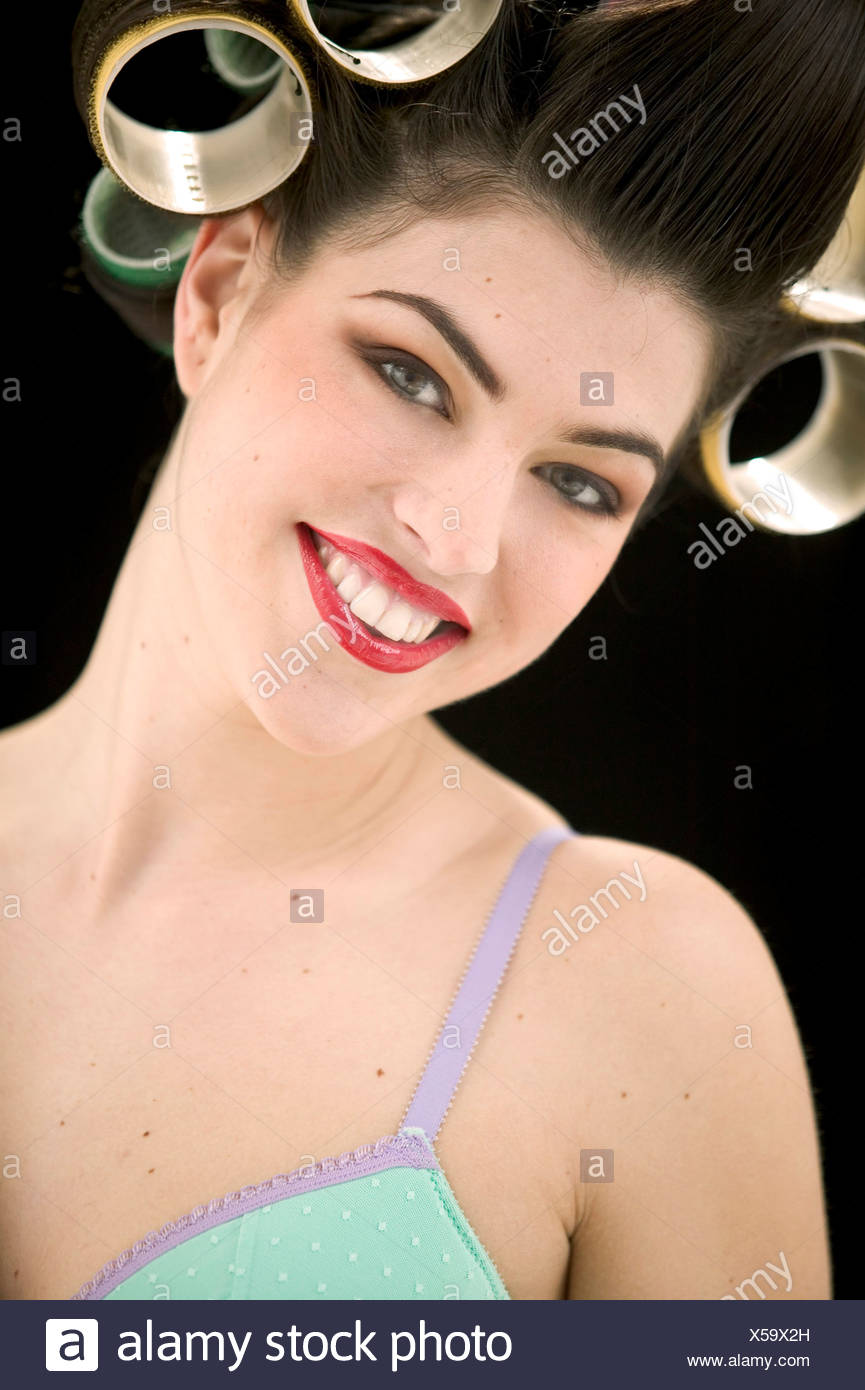 Female Brunette Hair In Rollers Brown Eyeshadow And Red Lipstick