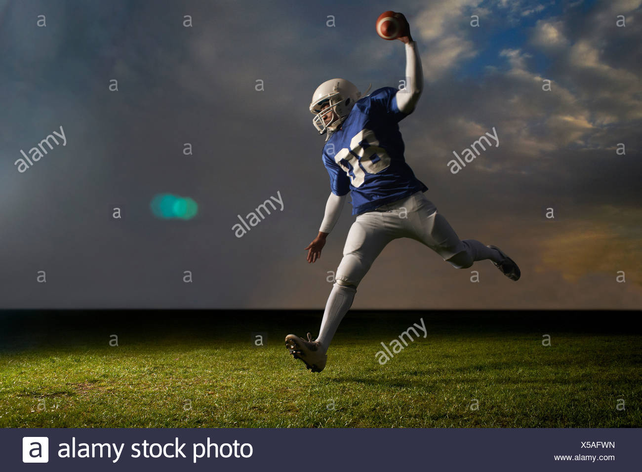 American football player in action - Stock Image