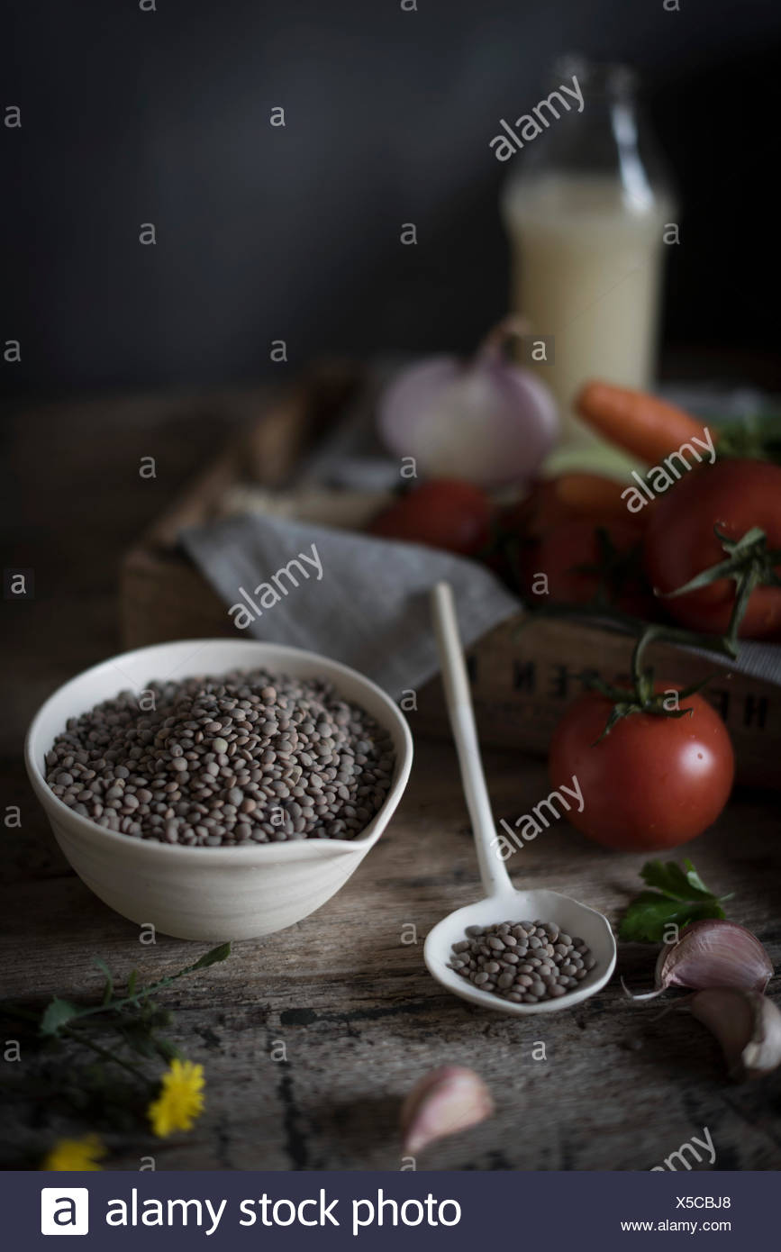 Lentils and tomatoes in a kitchen - Stock Image