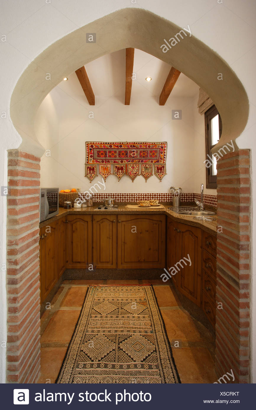 View Through Moroccan Style Arch To Small Spanish Kitchen With