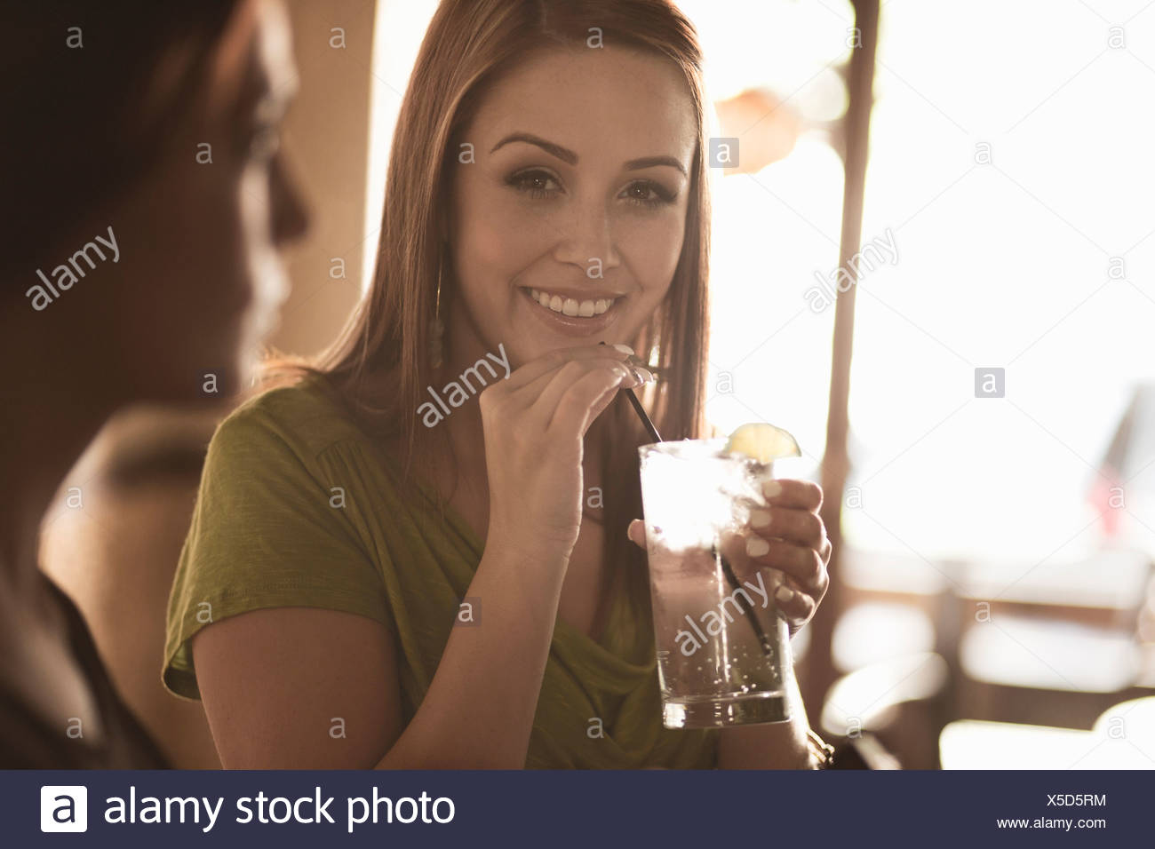 Female colleagues enjoying drinks in a wine bar - Stock Image