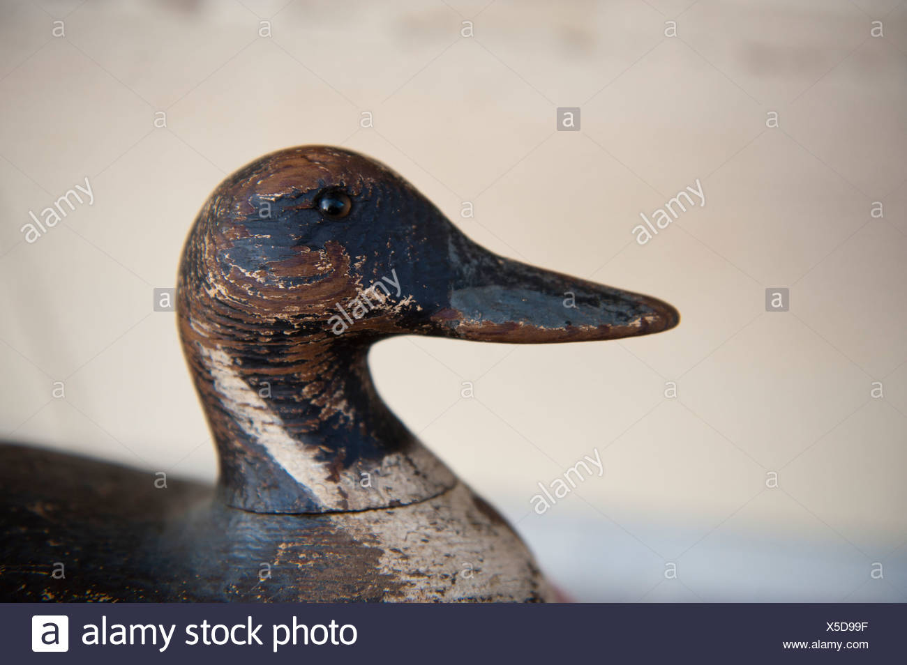 An antique duck decoy. - Stock Image