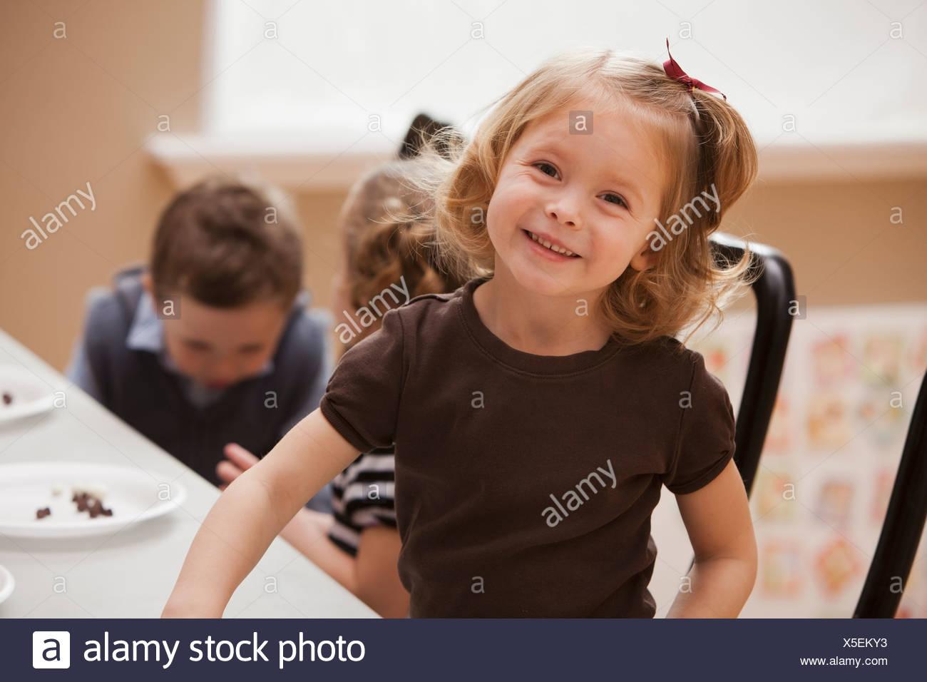 Portrait of girl (2-3) in kindergarten - Stock Image