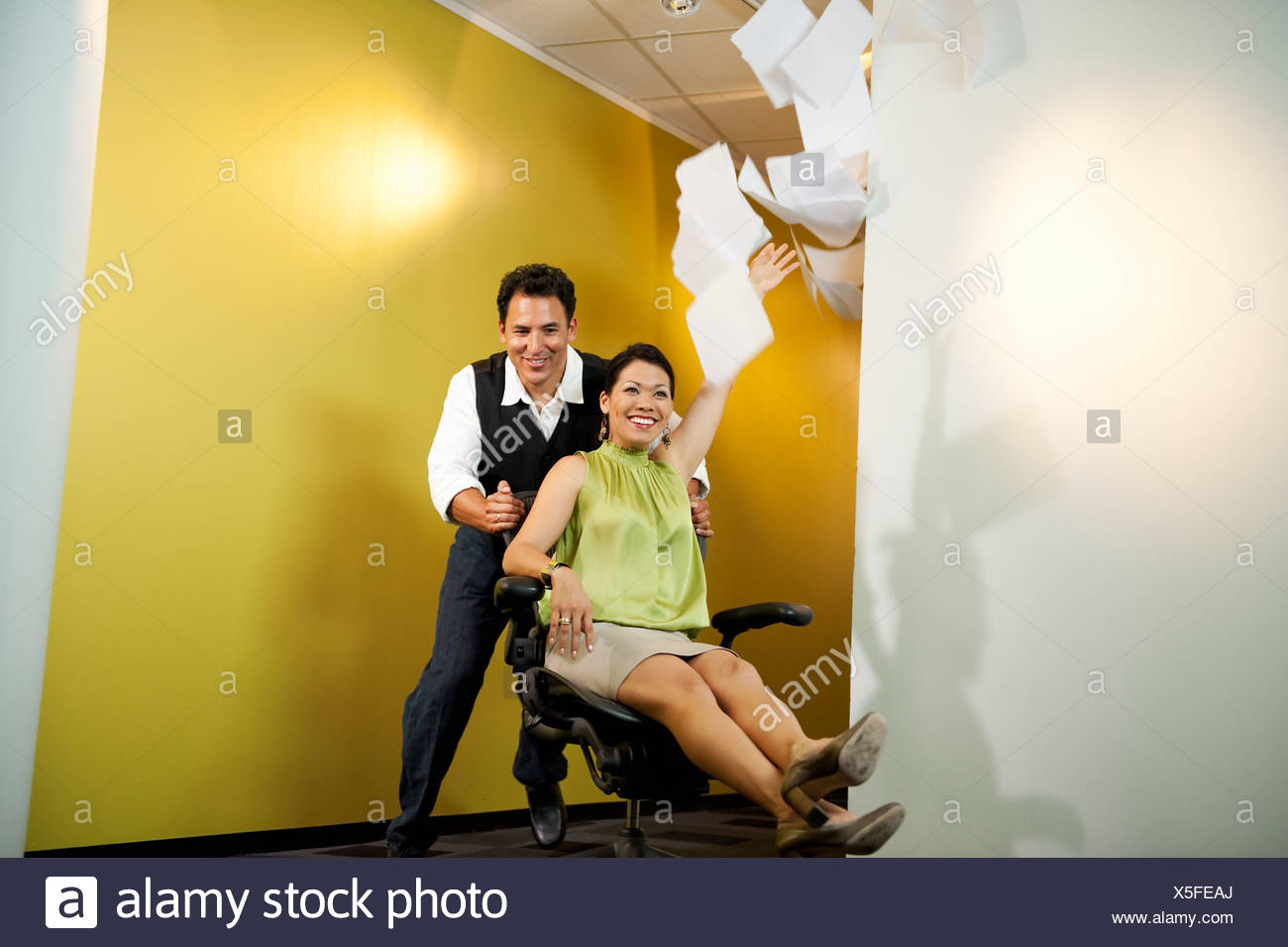 Office workers having fun - Stock Image
