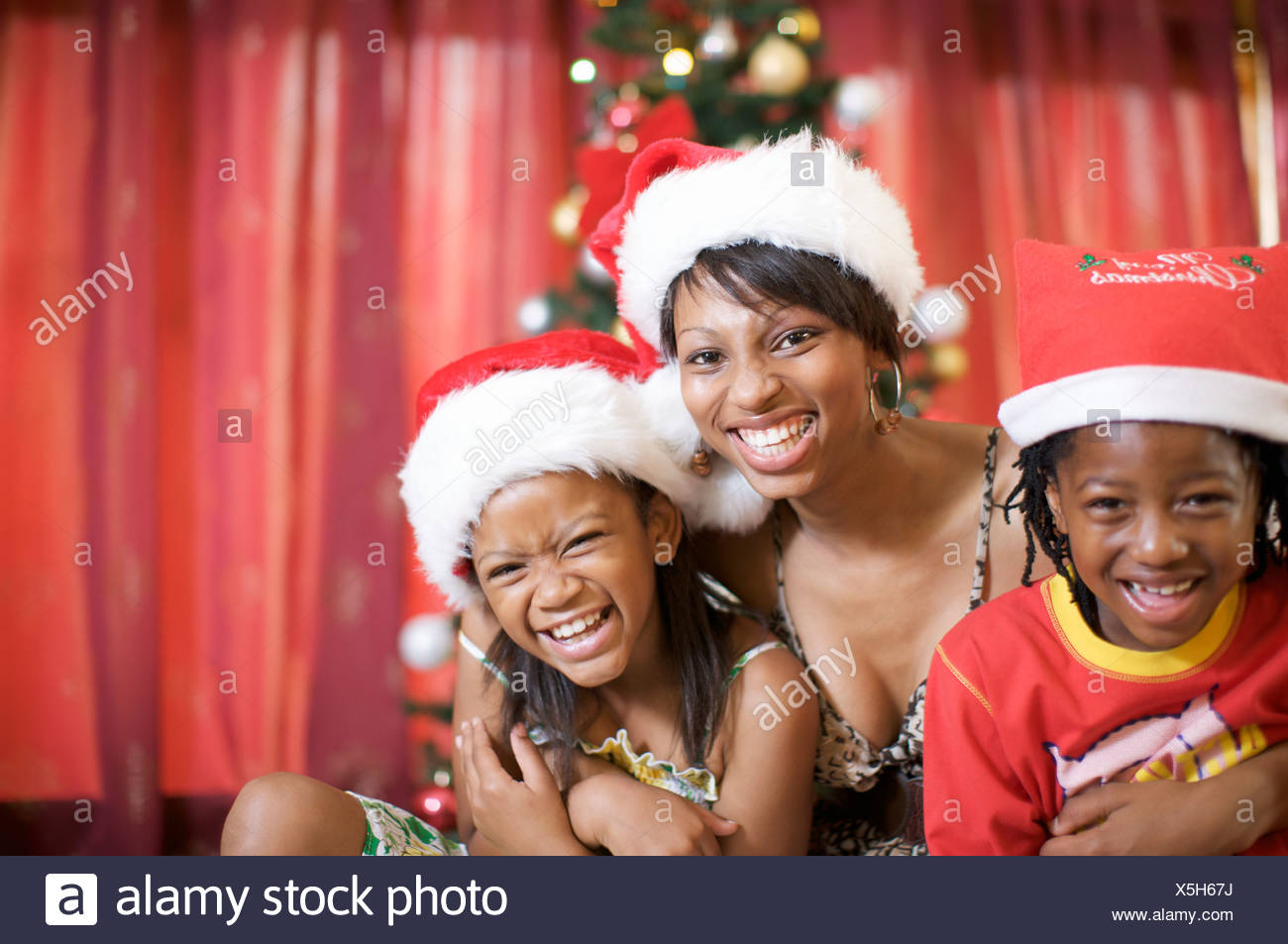 Mother and son and daughter laughing at Christmas, Pietermaritzburg, KwaZulu-Natal Province, South Africa - Stock Image