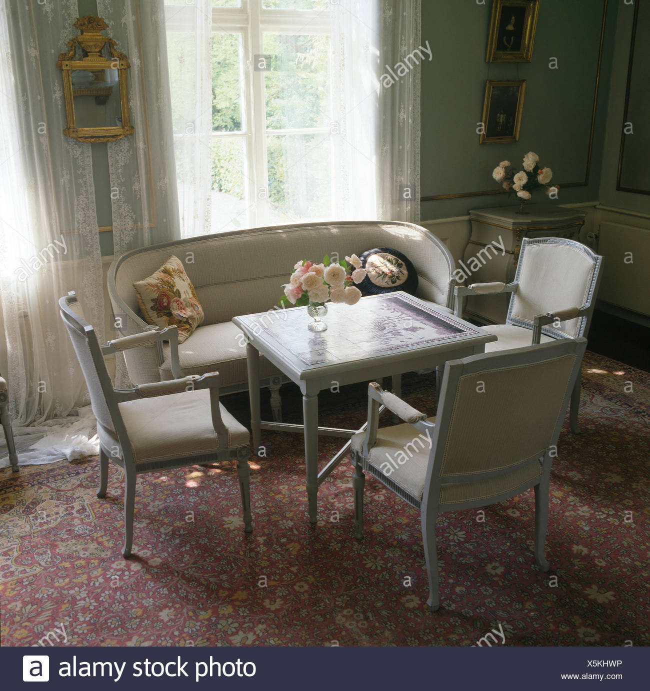 Gentil Grey Painted Chairs And Small Table In Swedish Dining Room
