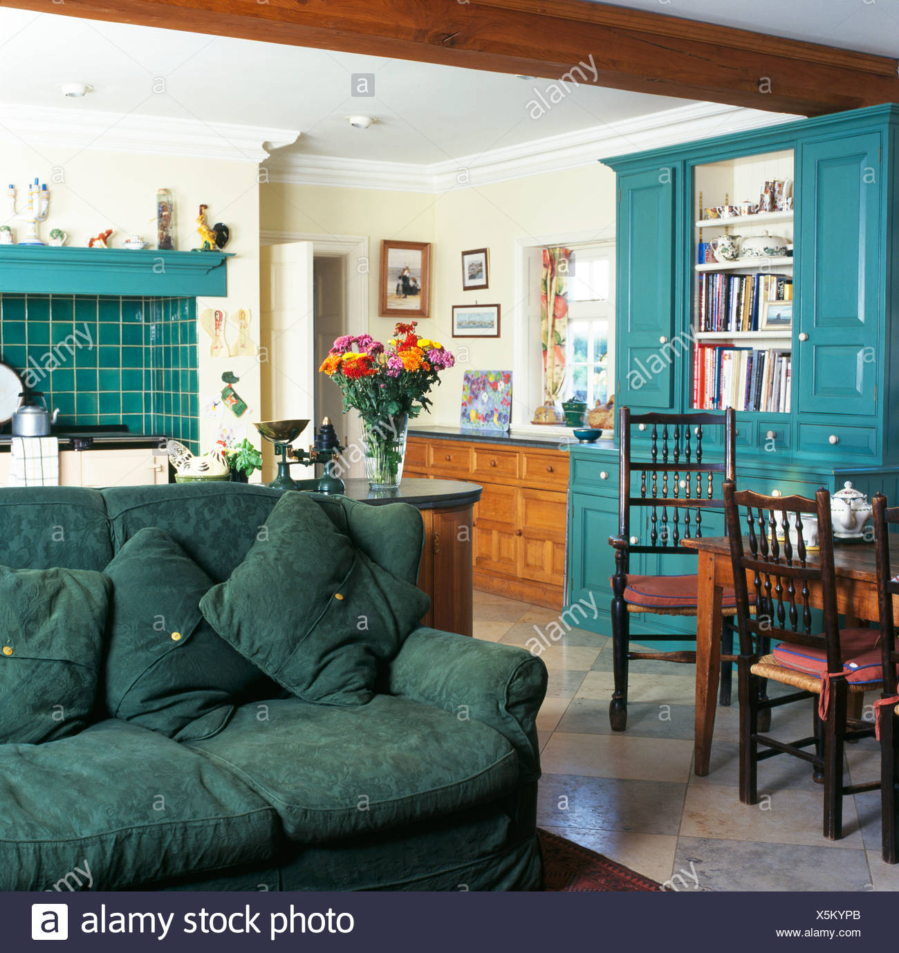 Green Sofa In Traditional Country Kitchen Dining Room With Turquoise  Painted Fitted Dresser