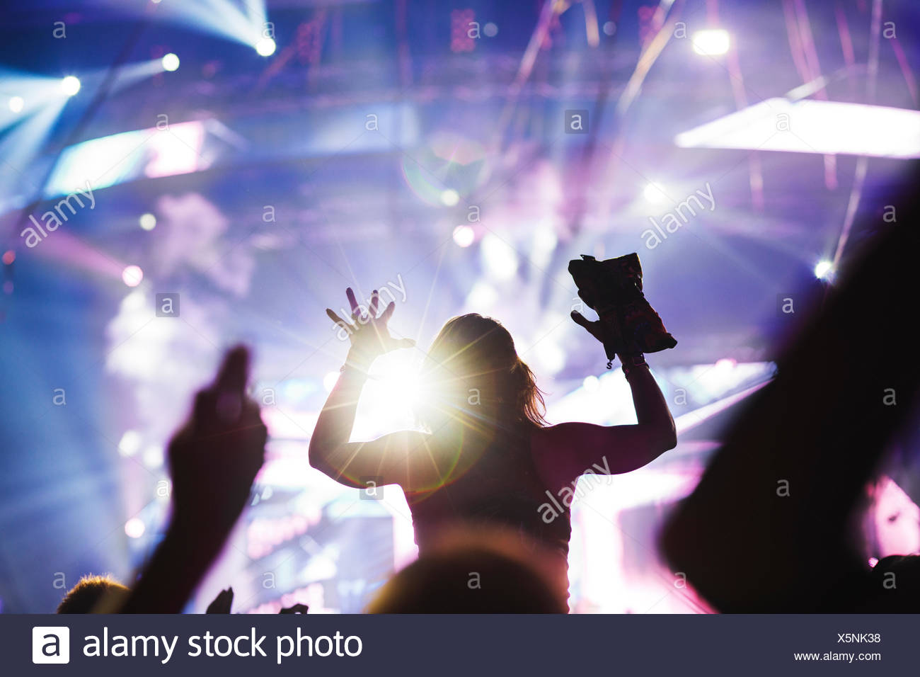 Finland, Uusimaa, Helsinki, Cheering young woman at Summer Sound Festival - Stock Image
