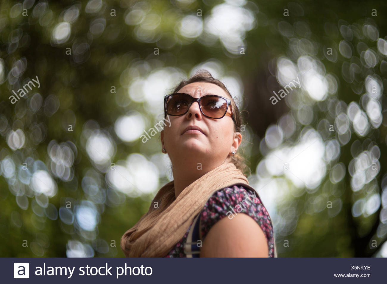 Portrait of a mid adult  woman in the park - Stock Image
