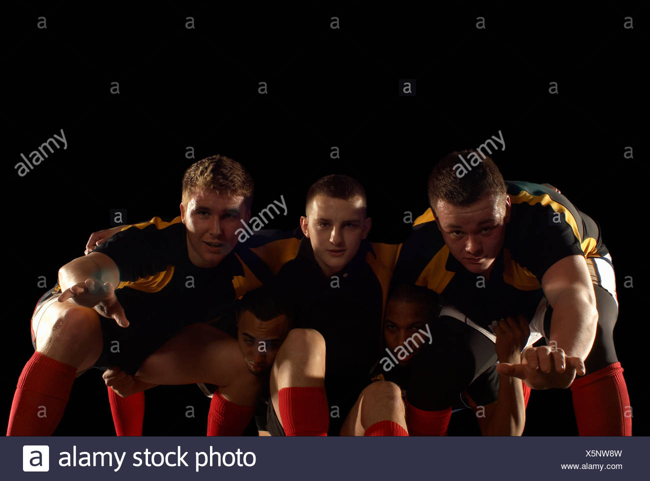 Rugby players in scrum formation - Stock Image