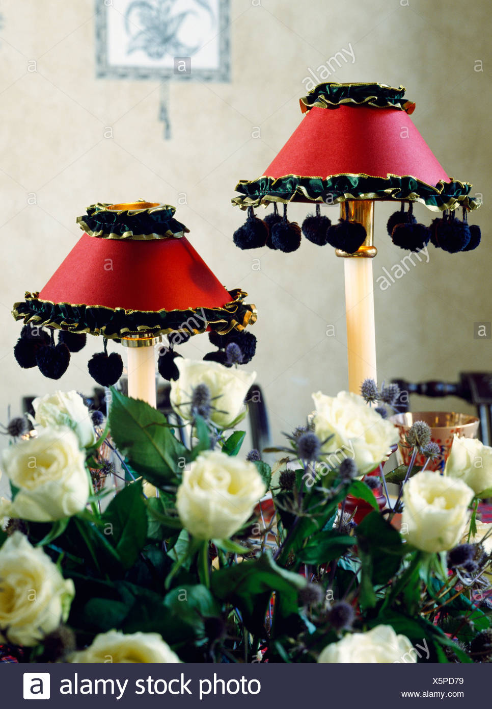 red black and white lamps floor lamp closeup of white roses in front lamps with red silk shades trimmed black bobble fringing