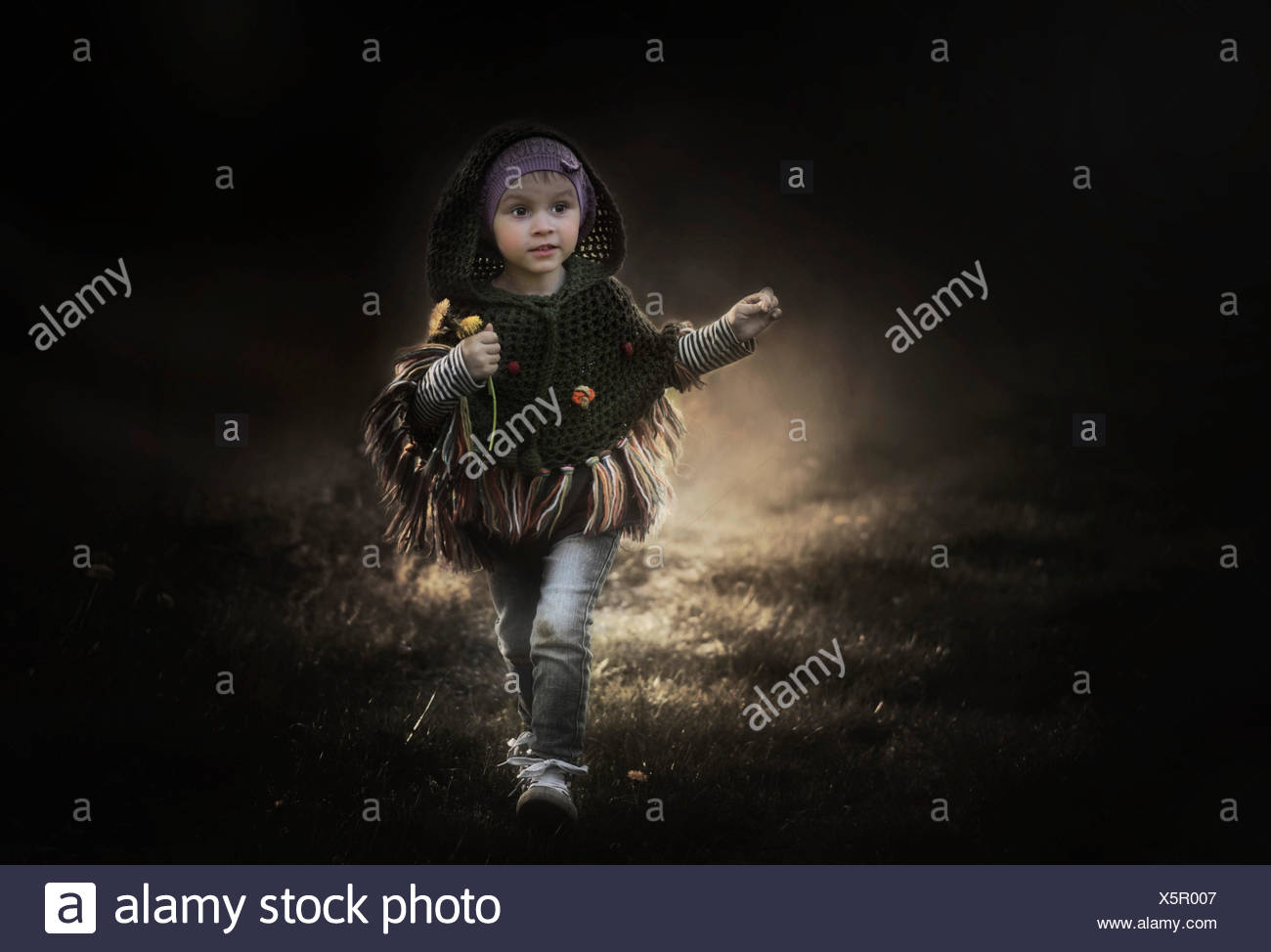 Girl running outdoors - Stock Image