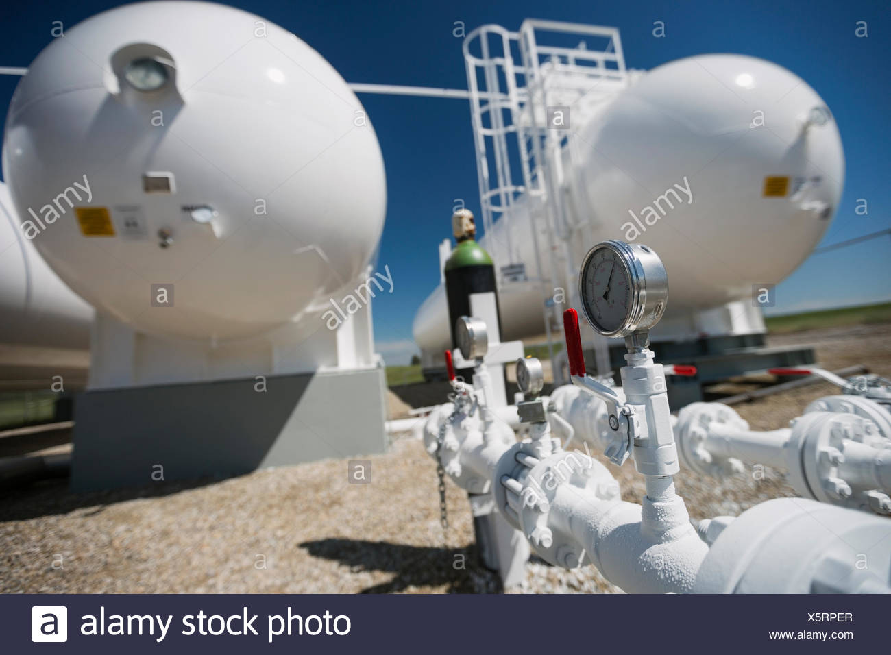 Gauge below natural gas containers - Stock Image