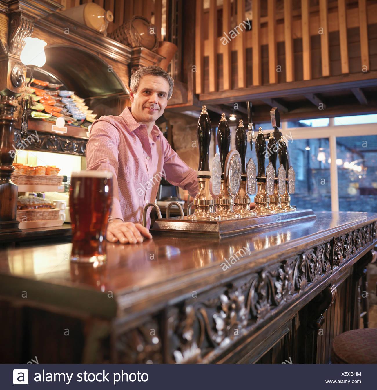 Landlord in English pub - Stock Image