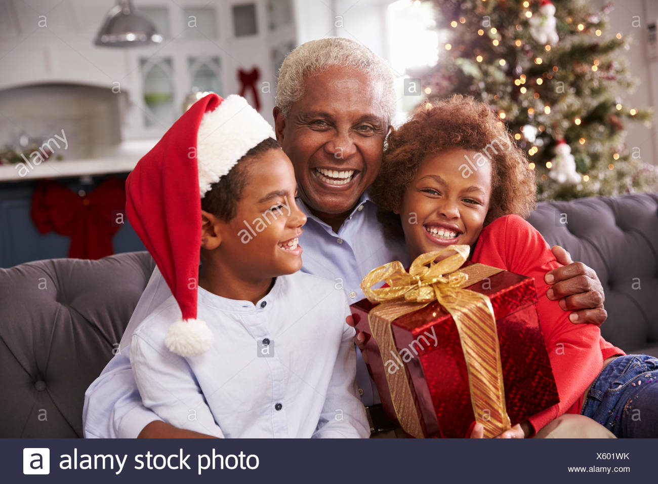 Grandfather With Grandchildren Opening Christmas Gifts Stock Photo ...