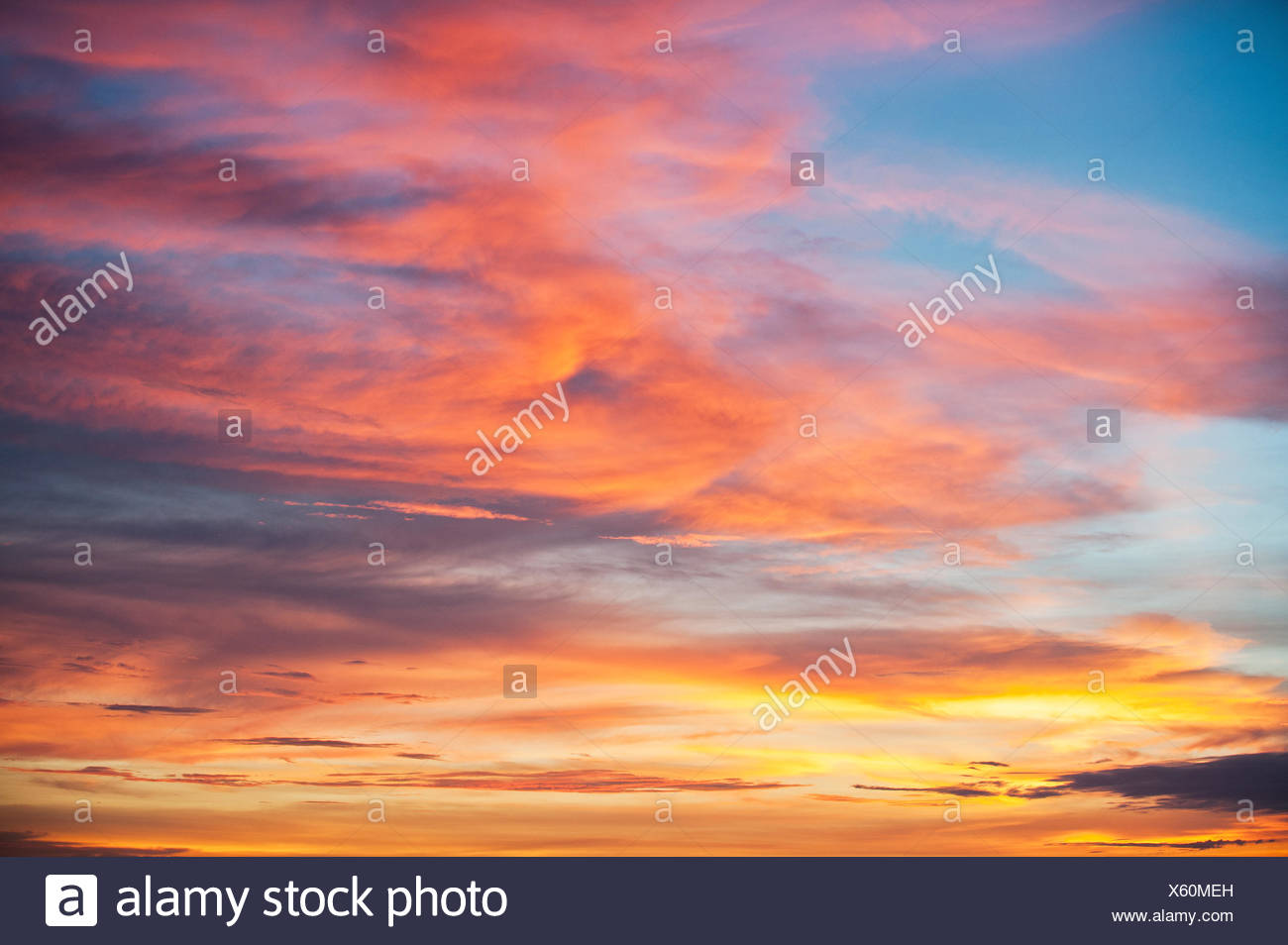 Sunset looking West to Irian Jaya, West Papua, Indonesia. - Stock Image