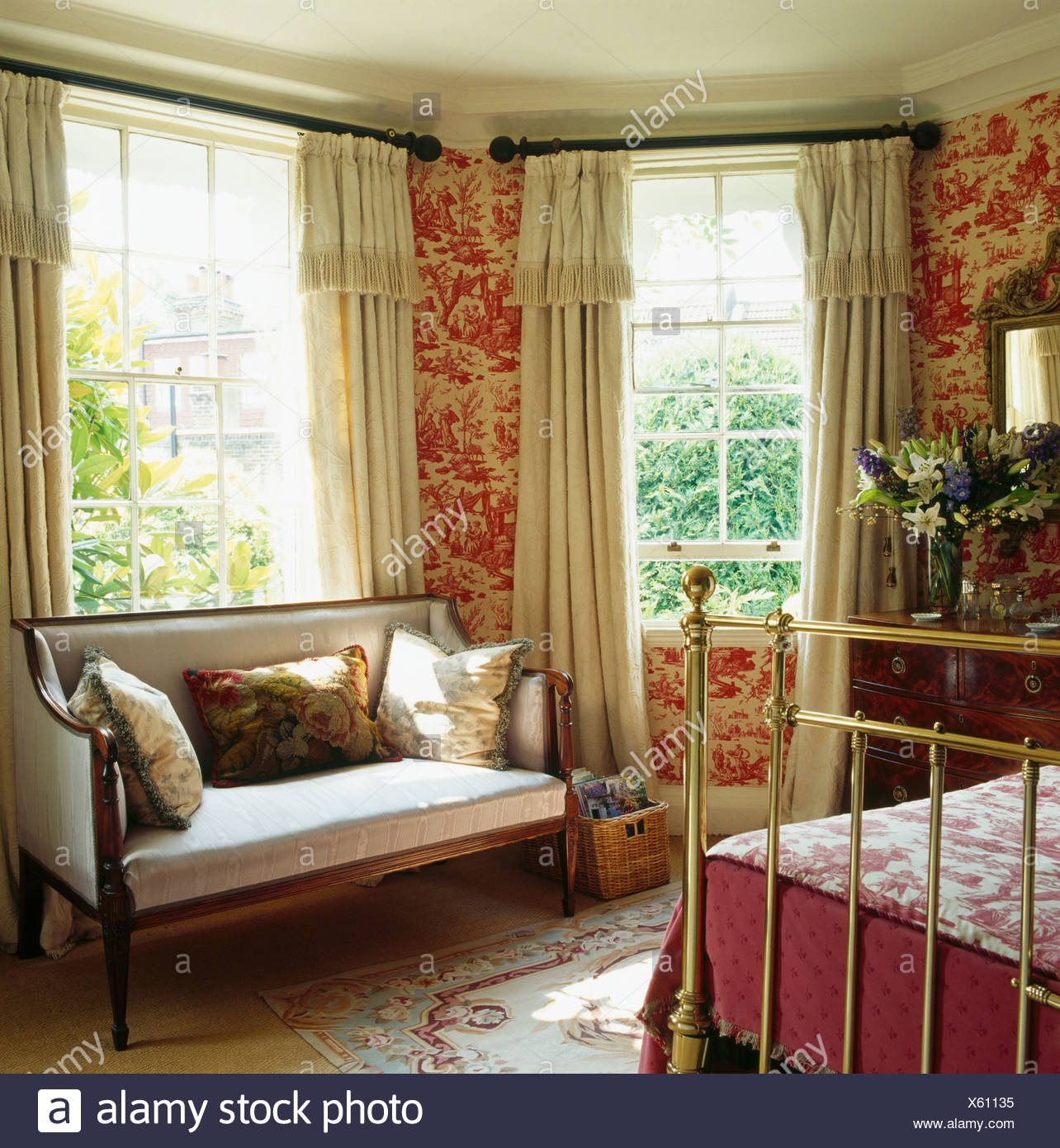 Great Red Toile De Jouy Wallpaper In Bedroom With Antique Sofa In Front Of Window  With Cream Curtains