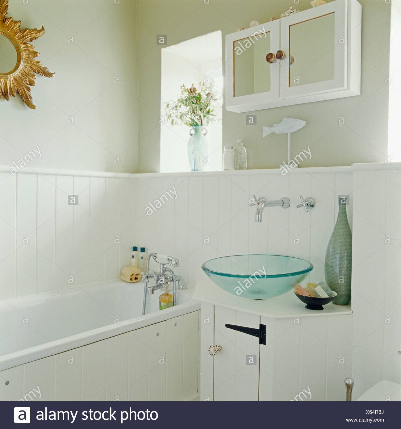 Modern glass basin bowl on small cupboard in country bathroom with ...