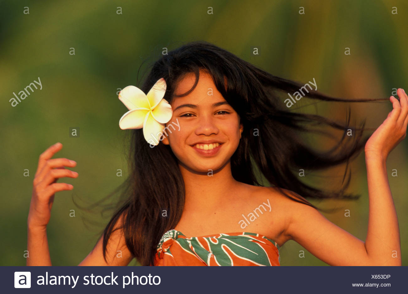Young local hawaiian girl smiling with flower in her hair stock young local hawaiian girl smiling with flower in her hair izmirmasajfo
