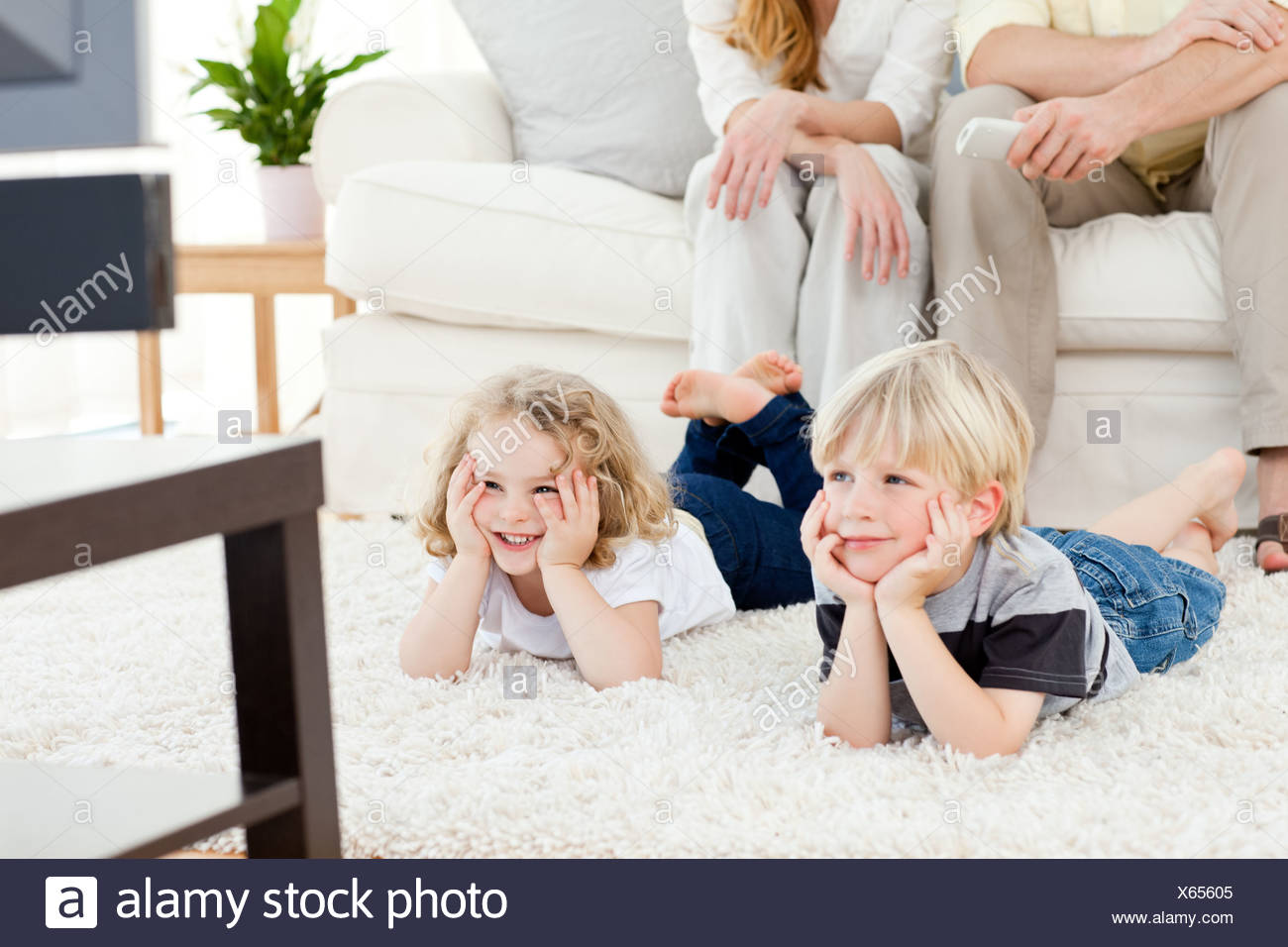 Adorable family watching tv - Stock Image