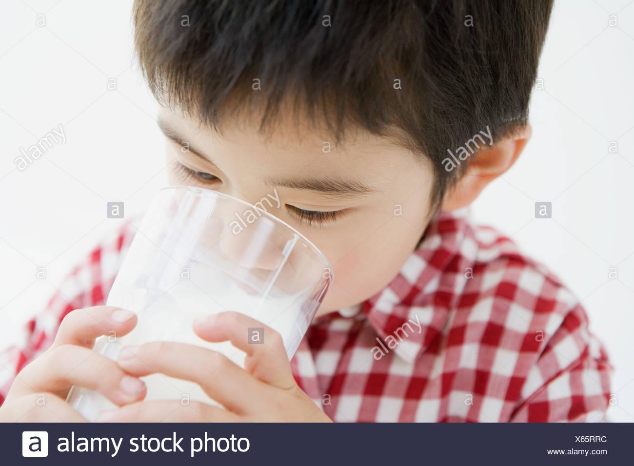 Asian boy drinking milk - Stock Image
