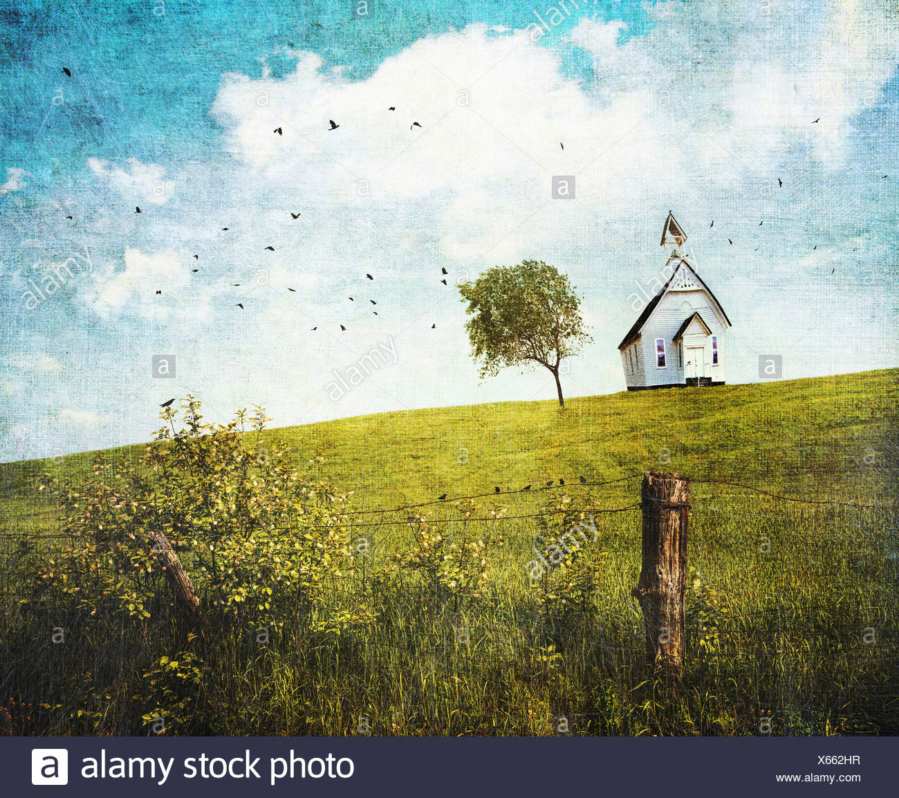 Old country school house  on a hill against a blue sky - Stock Image