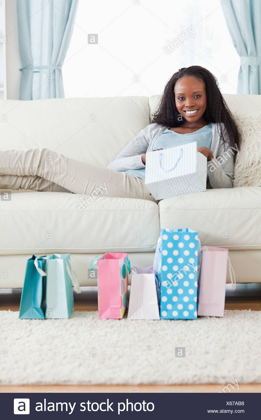 Woman taking a moment off after shopping - Stock Image