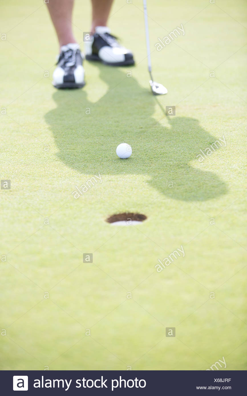 Low section of man playing golf - Stock Image