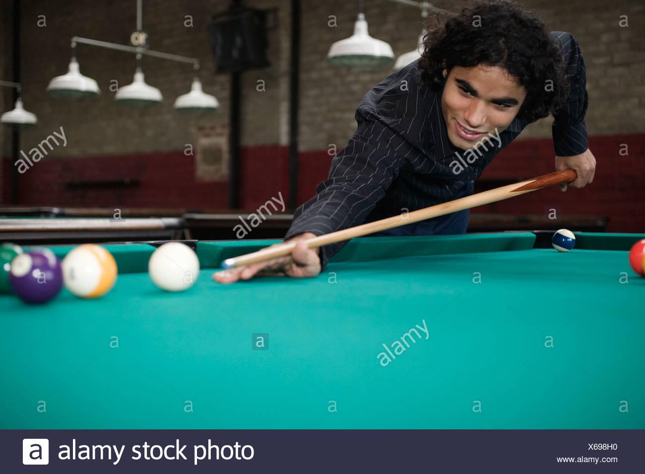 Latin mature playing billard