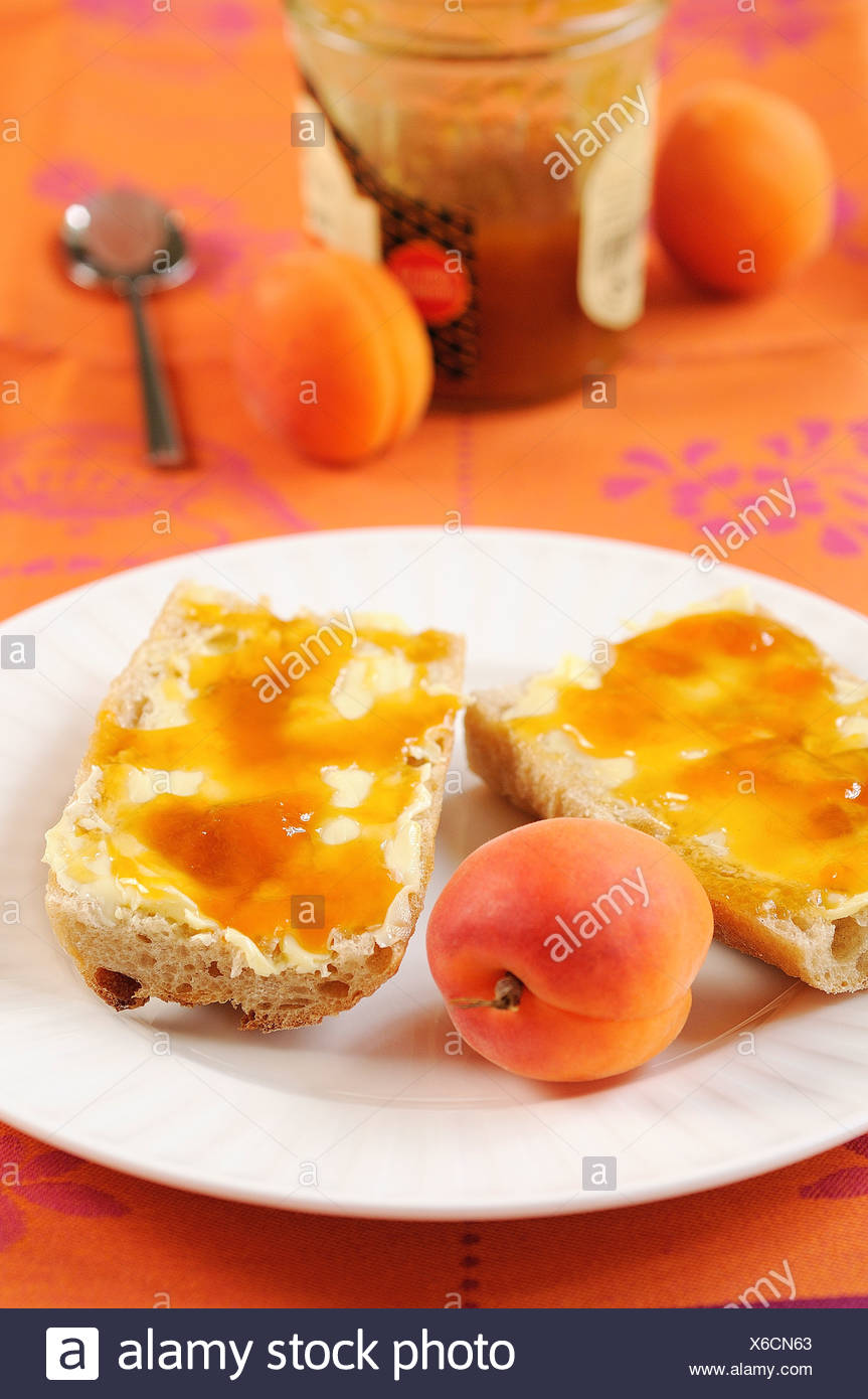 Bread,butter and apricot jam - Stock Image