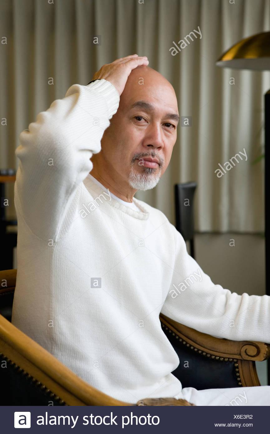Senior man looking at camera - Stock Image