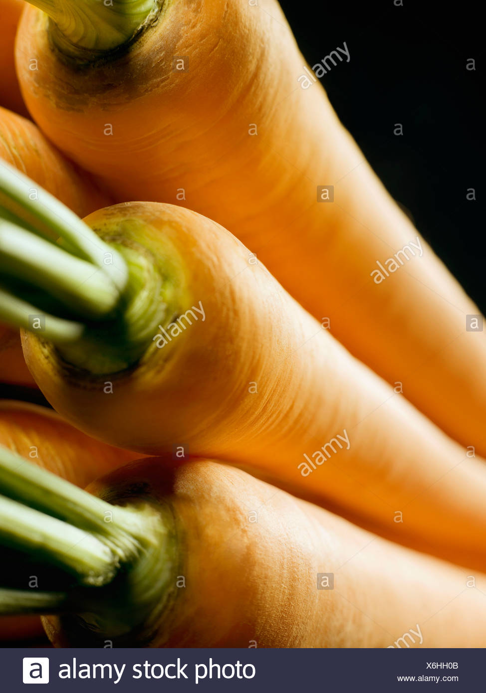 A cropped shot of a pile of carrots - Stock Image