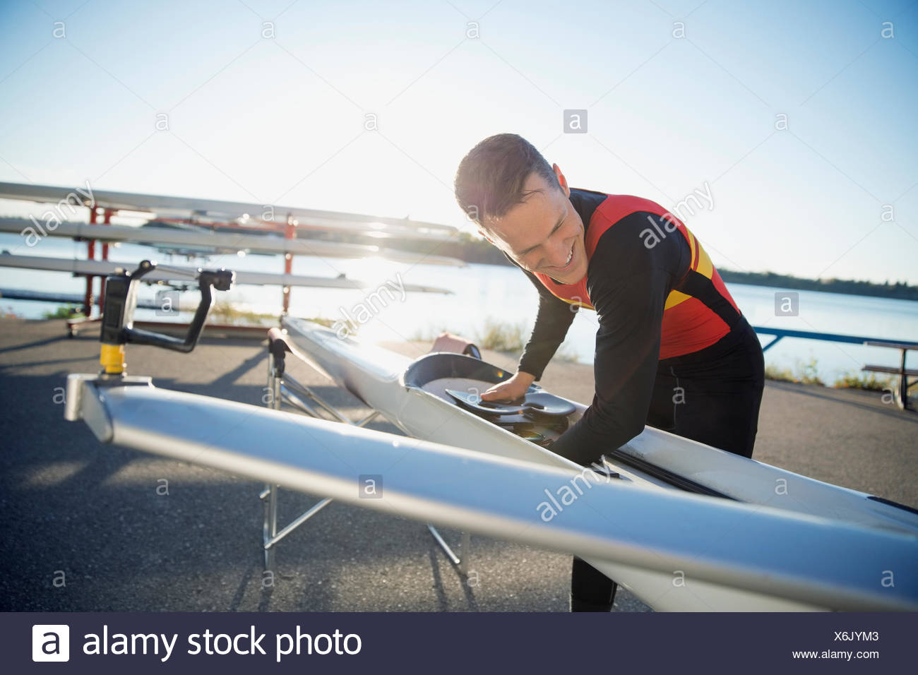 Rower with scull at waterfront - Stock Image
