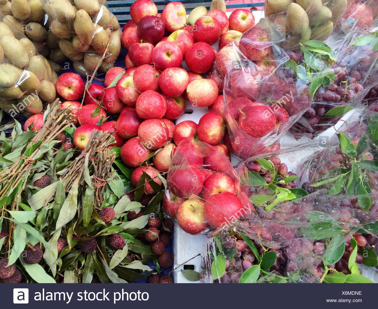 Fruits on market stall - Stock Image