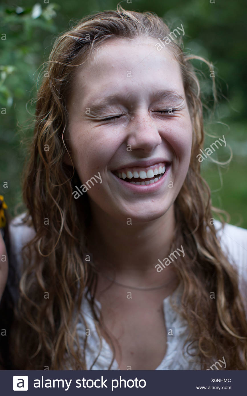 Woman laughing with eyes closed - Stock Image