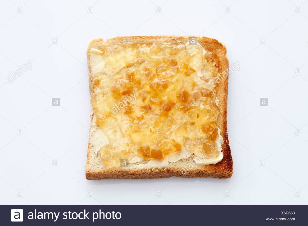 slice of toast toasted slice of bread with ginger jam stock photo