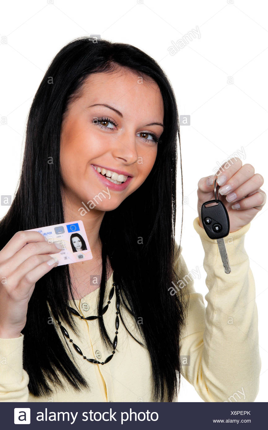 woman with car keys and driver's license - Stock Image