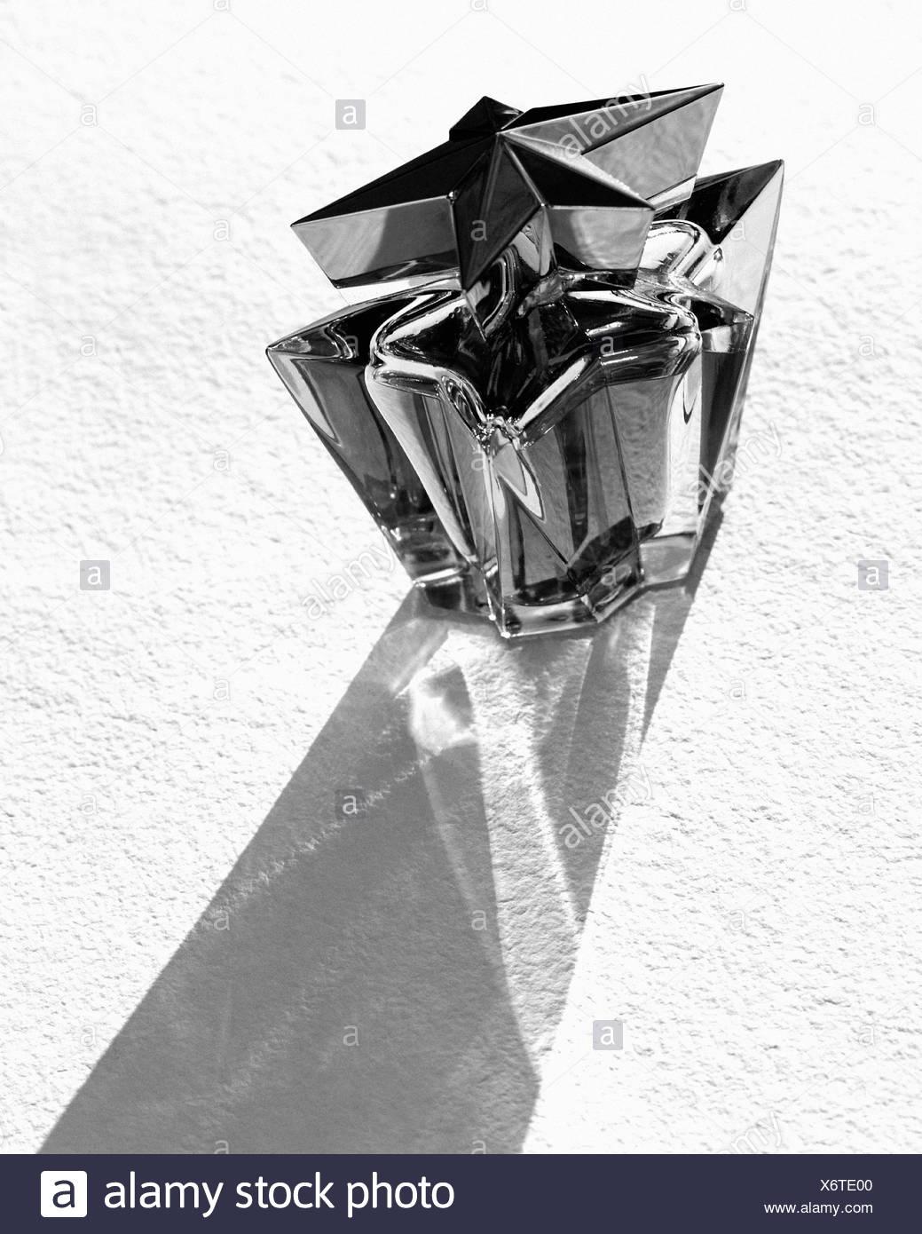 Trendy bottle of perfume - Stock Image