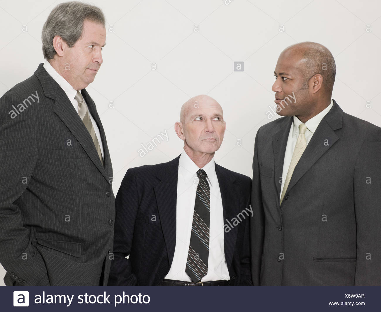 Tall and short businessmen - Stock Image