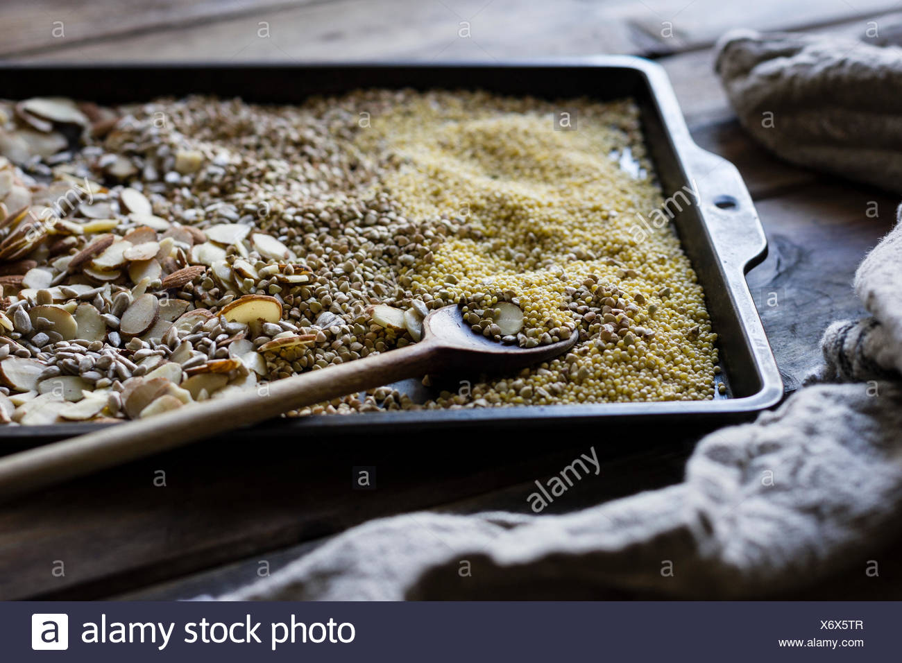 Cooking of a Gluten-Free Vegan Nut and Seed Bread - Stock Image